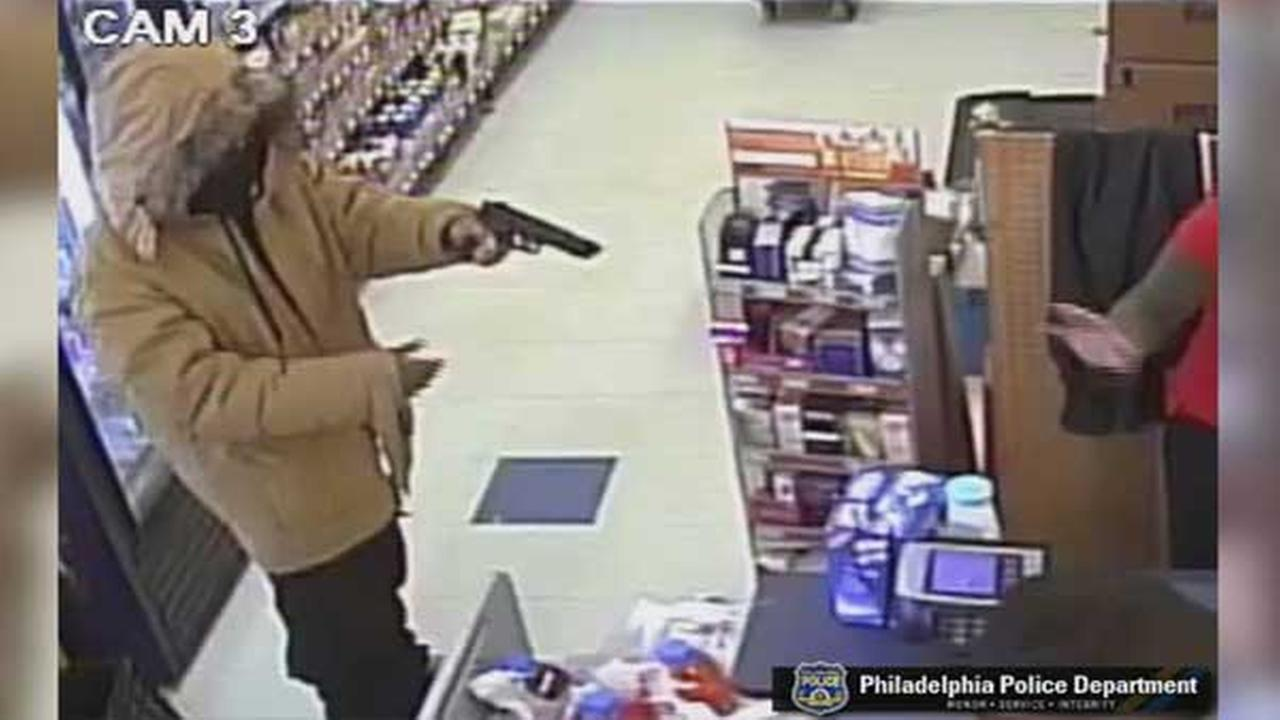 Philadelphia police are looking to identify a masked gunman who robbed a dollar store in tehe citys Olney section Monday night.