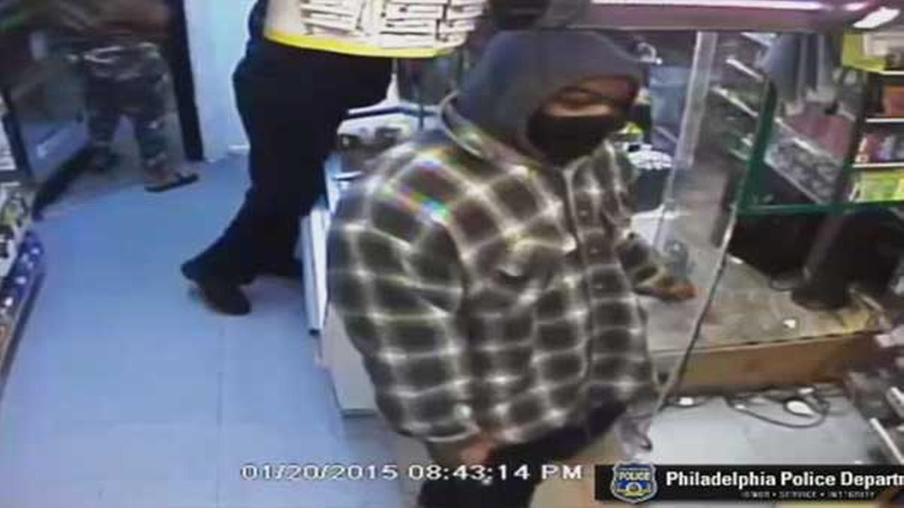 Philadelphia police are searching for two armed suspects who robbed a mini market in the citys Logan section Tuesday night.