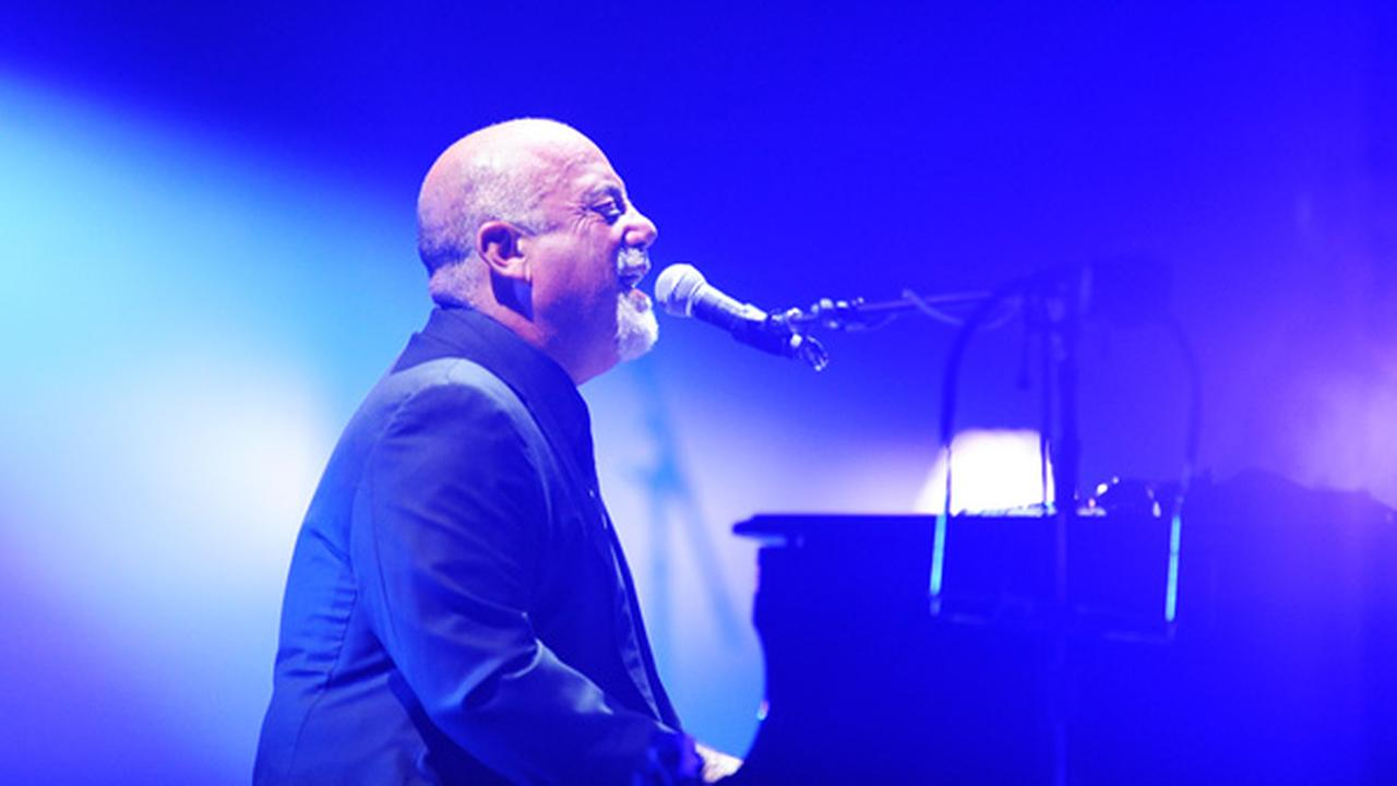 In this photo provided by the Las Vegas News Bureau, Billy Joel performs at the MGM Grand Garden Arena in Las Vegas Saturday, June 7, 2014.