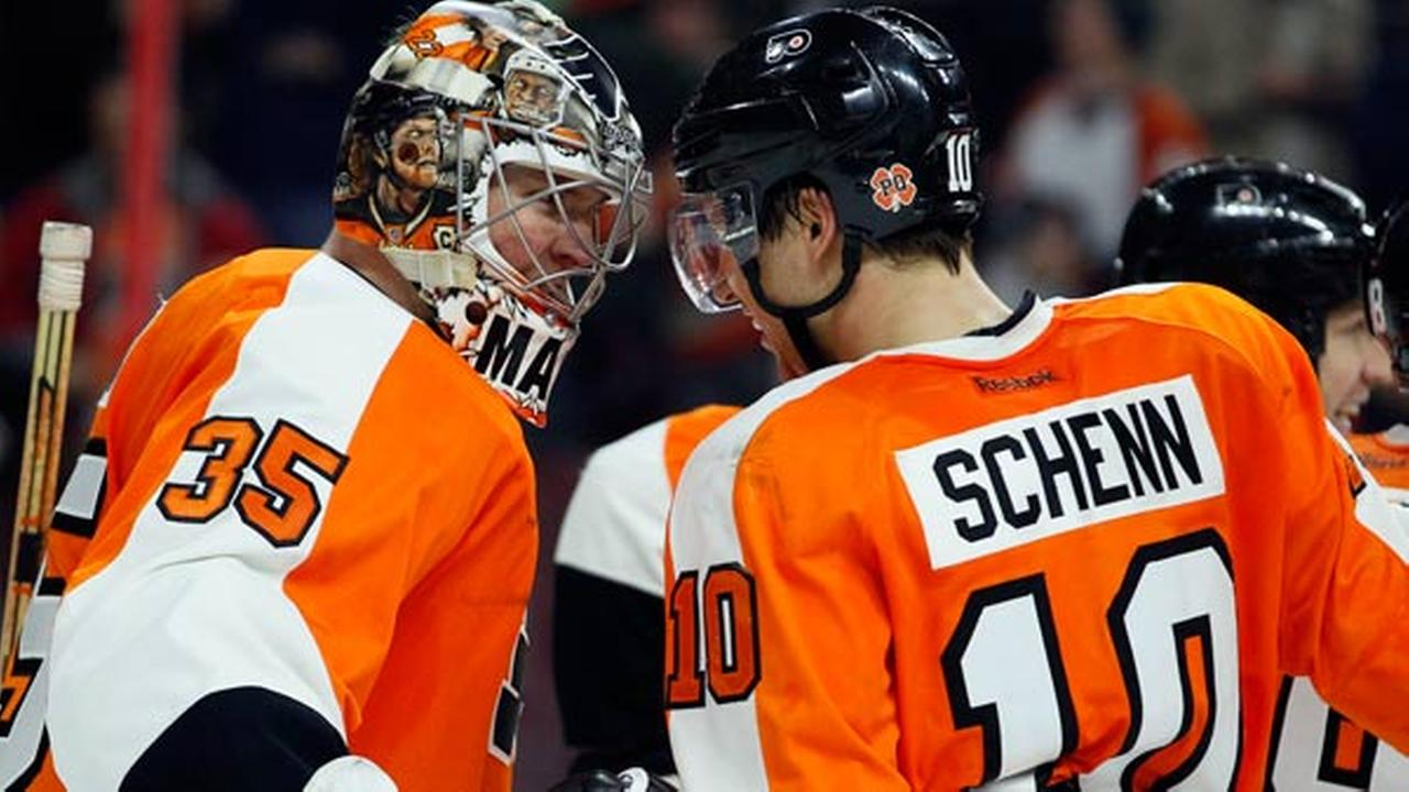 Philadelphia Flyers Steve Mason (35), left, and Brayden Schenn (10), right, celebrate the win in the overtime shoot-out of an NHL hockey game, Tuesday, Jan. 27, 2015,