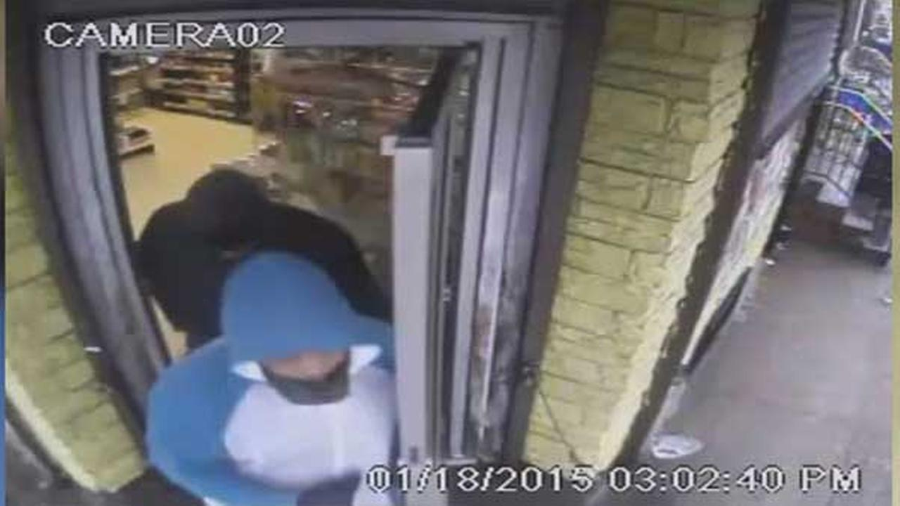 Philadelphia police are searching for two suspects who robbed a food market at gunpoint in the citys Point Breeze section.