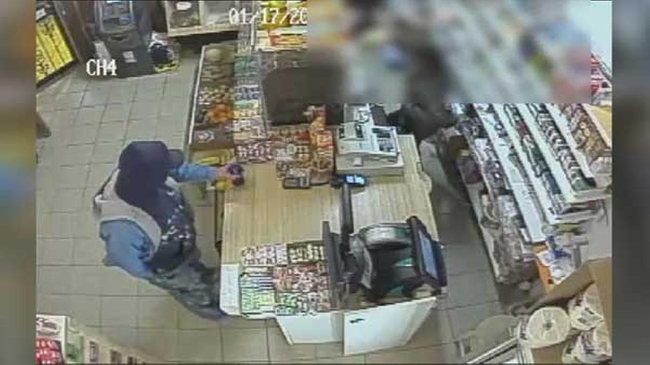 Police are searching for a suspect who stole the entire cash register during a robbery inside a food mart in South Philadelphia.