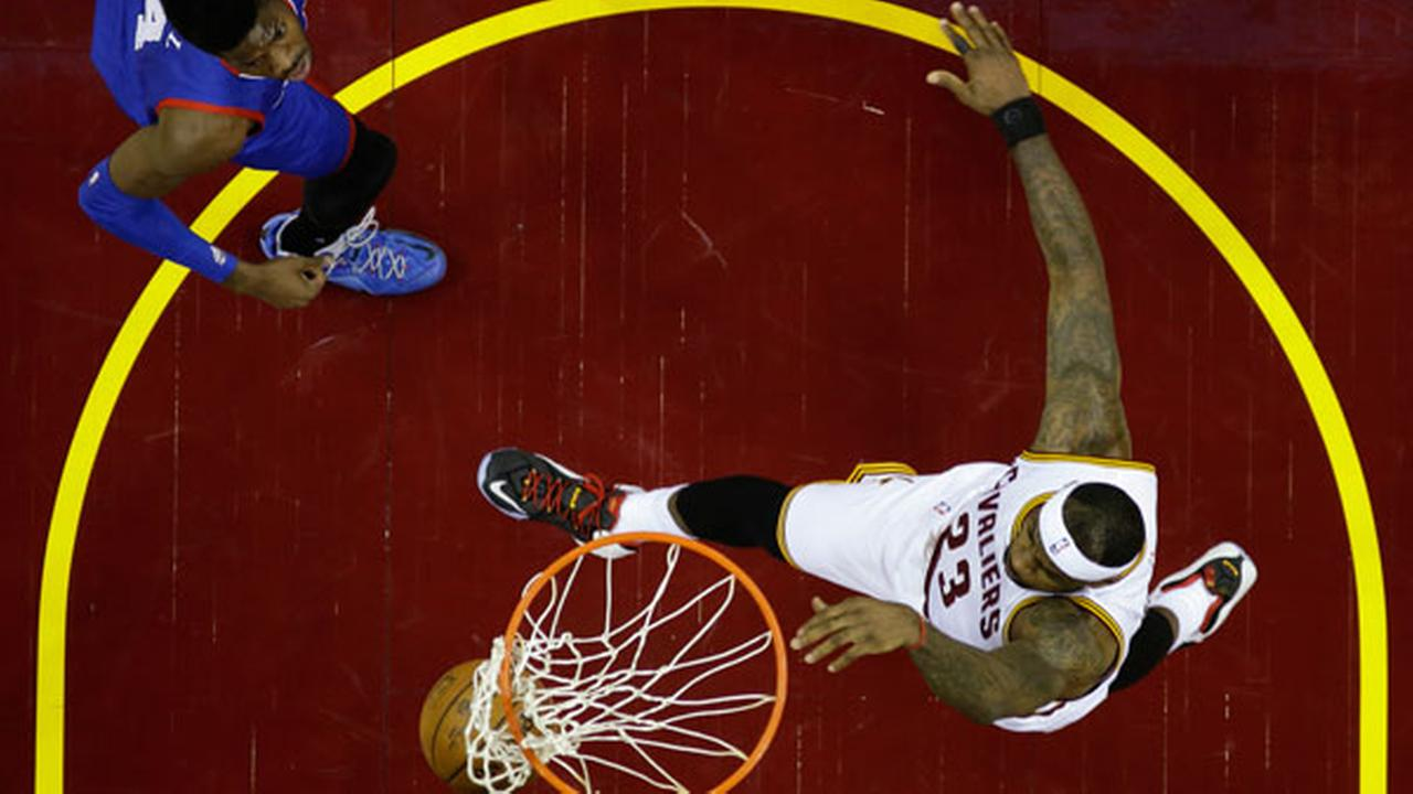 Cleveland Cavaliers LeBron James dunks against the Philadelphia 76ers in an NBA basketball game Monday, Feb. 2, 2015, in Cleveland. (AP Photo/Mark Duncan)
