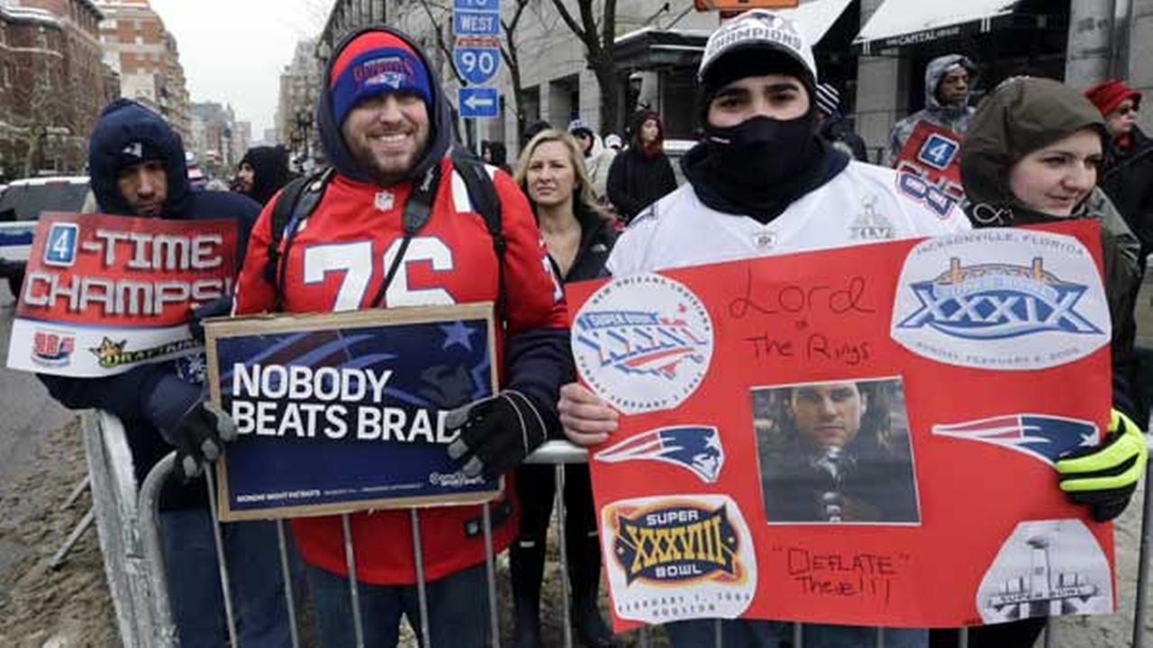 New England Patriots fans wait for the start of a parade in Boston Wednesday, Feb. 4, 2015, to honor the Patriots victory over the Seattle Seahawks in Super Bowl XLIX.
