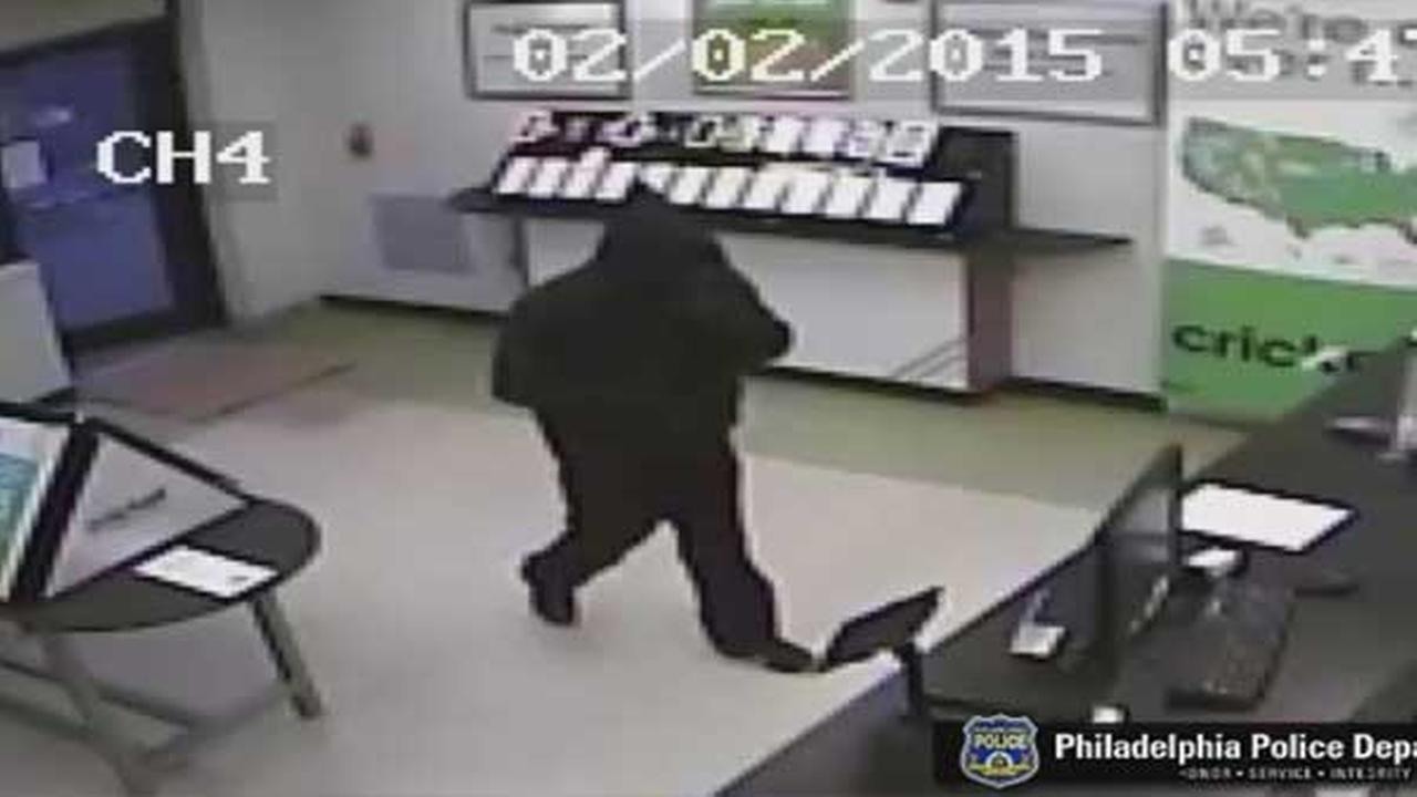 Philadelphia police are searching for a masked gunman who held up a cell phone store in the citys Logan section.