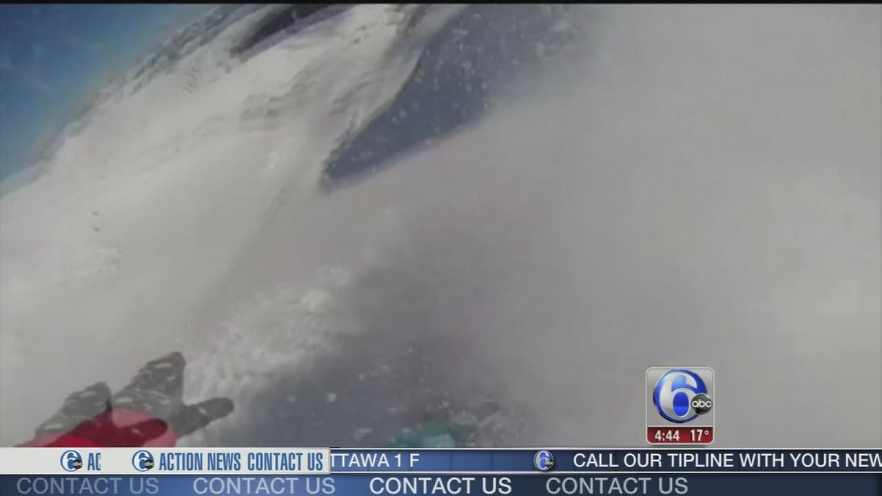 VIDEO: Snowboarder survives avalanche