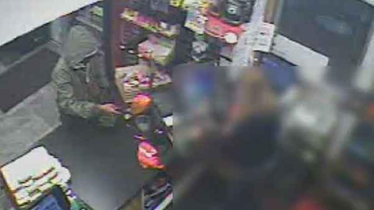 Police have released surveillance video of an armed robbery inside a gas station in South Philadelphia.