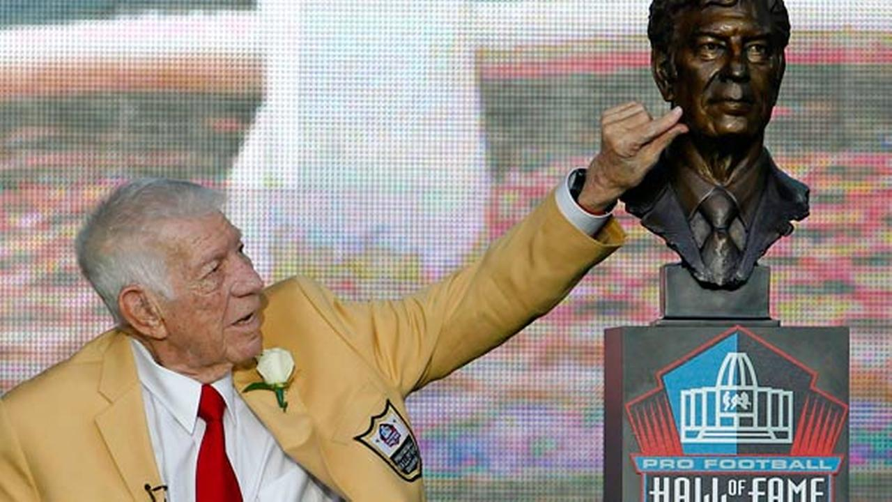 Ed Sabol touches a bust of himself after it was unveiled during the induction ceremony at the Pro Football Hall of Fame, Saturday, Aug. 6, 2011, in Canton, Ohio.