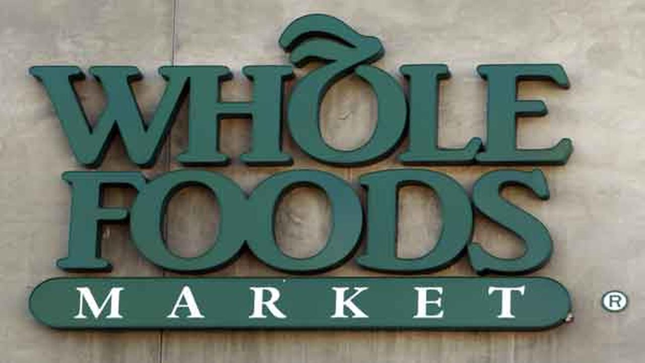 FILE - The Whole Foods Market logo is seen outside a store in Santa Monica, Calif.