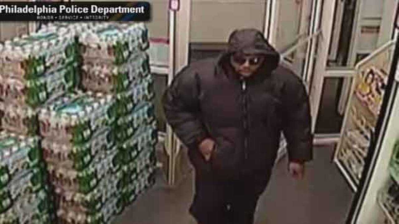 Philadelphia police have released surveillance of an armed suspect who robbed a drug store and attacked a store clerk in the citys East Mount Airy neighborhood Tuesday night.