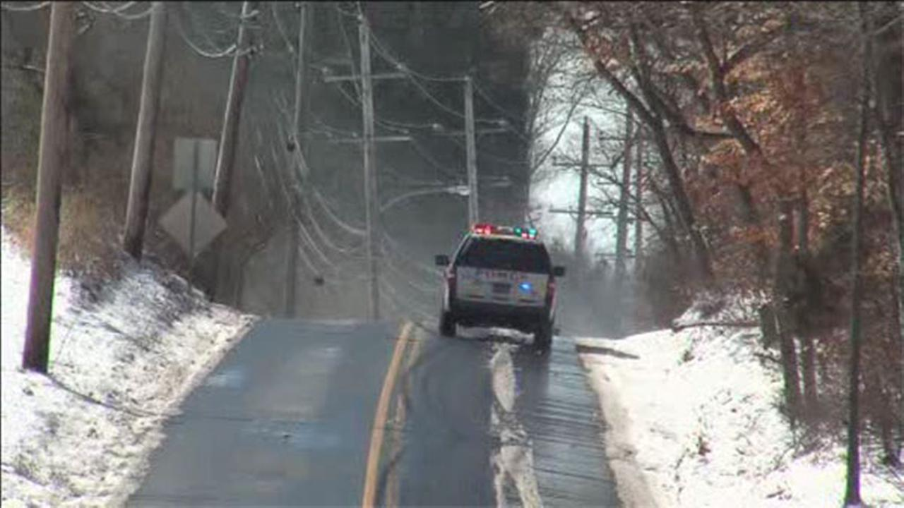 Car crashes in snowy conditions in Langhorne, Pa.