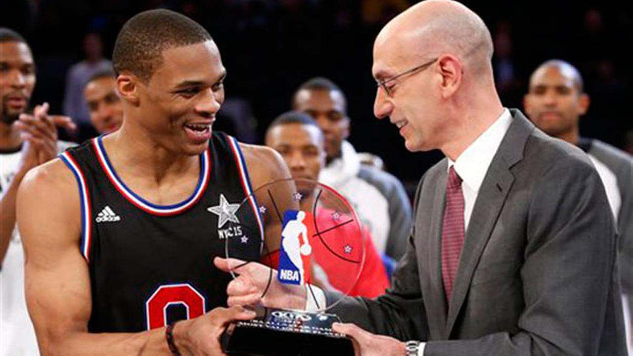 NBA Commissioner Adam Silver, right, hands West Teams Russell Westbrook, of the Oklahoma City Thunder, the MVP trophy after the NBA All-Star basketball game, Sunday, Feb. 15, 2015
