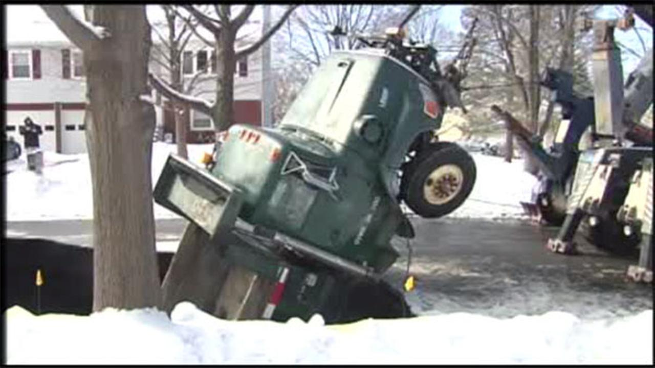 Sinkhole swallows snow plow in north Jersey