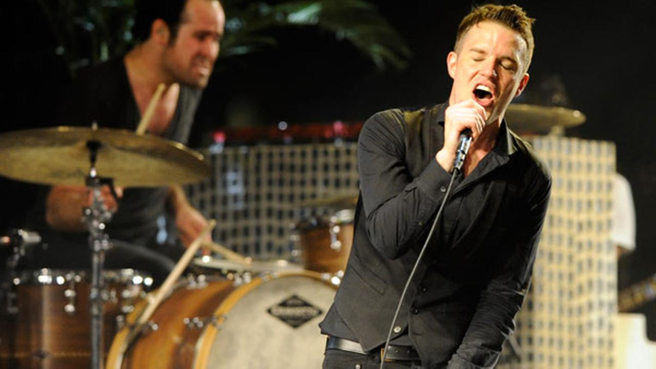 FILE - In this April 18, 2009 file photo, Brandon Flowers of The Killers performs during the bands headlining set on the second day of Coachella.