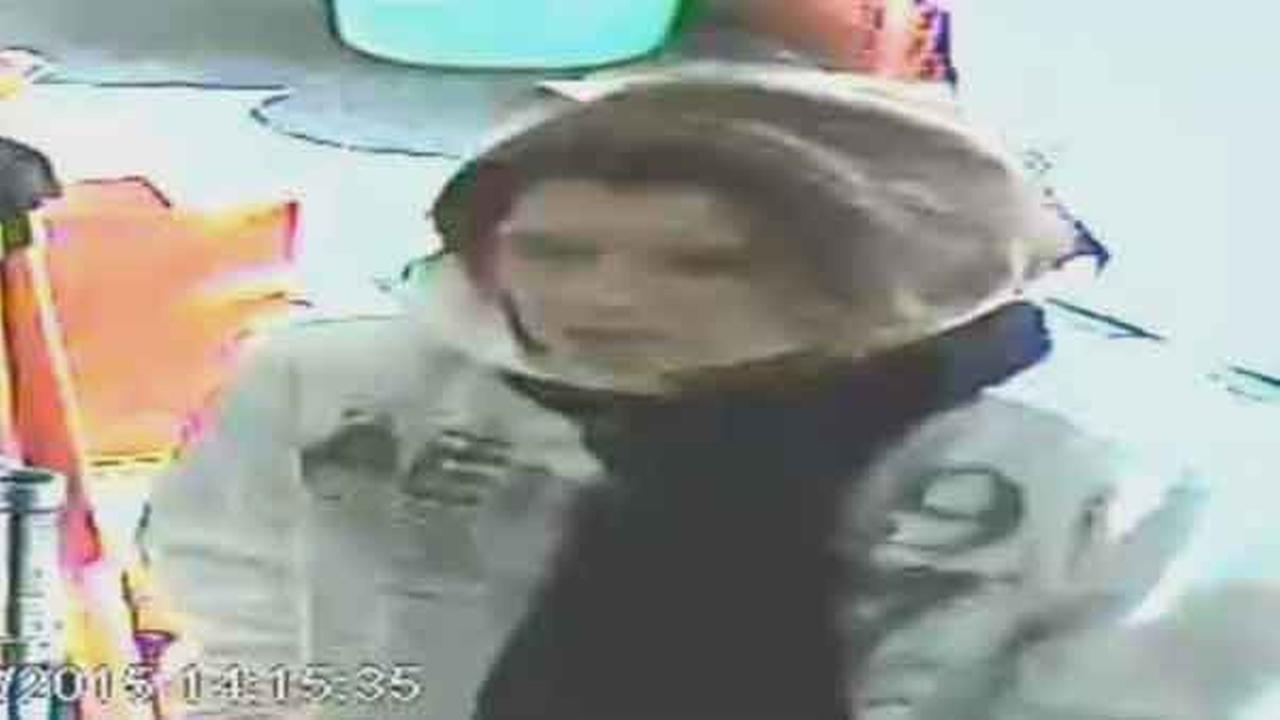 Police are looking to identify a woman who injured a store clerk during a robbery inside a dollar store in South Philadelphia.
