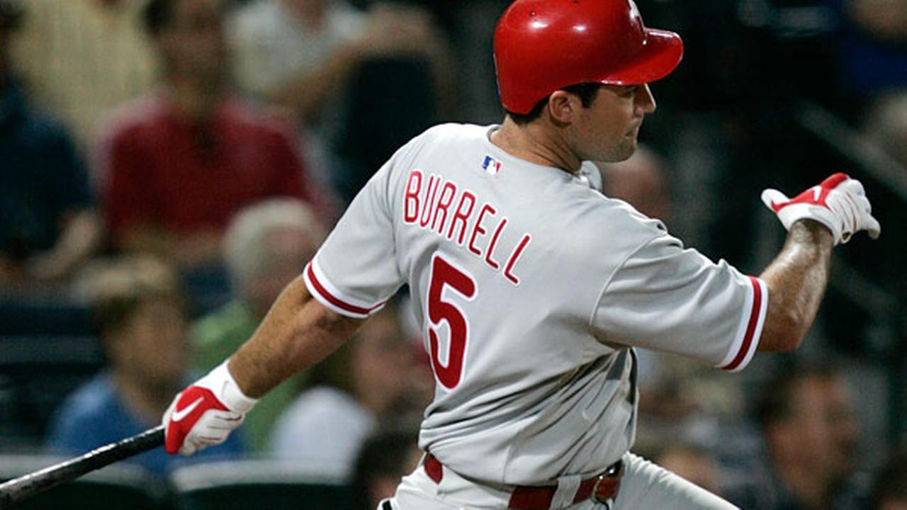 FILE - Philadelphia Phillies Pat Burrell hits a single in the eighth inning of a baseball game against the Atlanta Braves, Thursday, Sept. 18, 2008, in Atlanta.