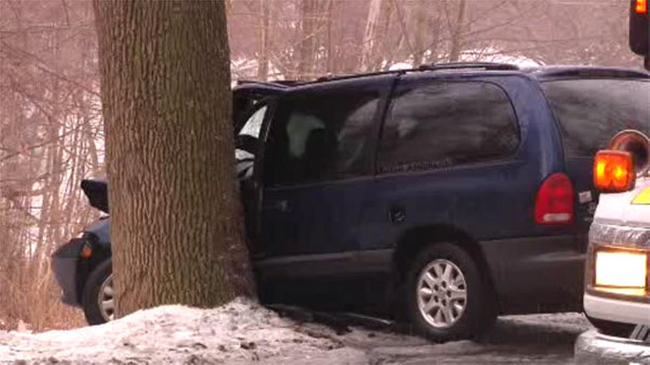 Minivan hits tree after crash on icy Delco road