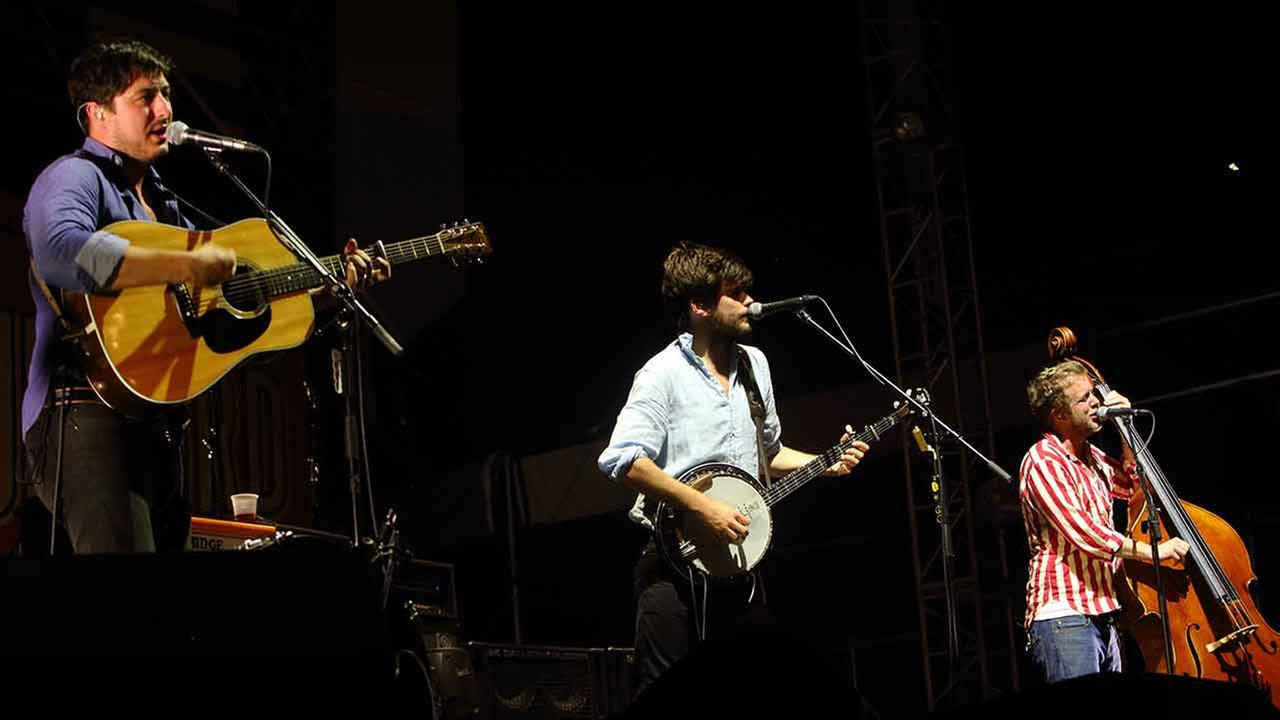Marcus Mumford, Winston Marshall, and Ted Dwane of Mumford and Sons perform at the Gentlemen of the Road stop at Francis Field on Saturday September 14, 2013 in St. Augustine FL.
