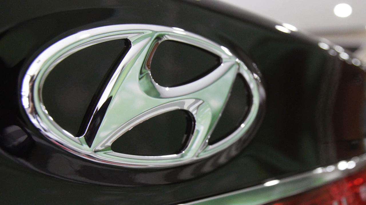In this July 26, 2012 file photo, the logo of Hyundai Motor Co. is seen on its car at the companys showroom in Seoul, South Korea. (AP Photo/Ahn Young-joon, File)