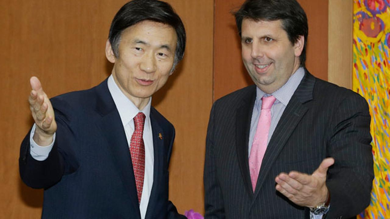 FILE - New U.S. Ambassador to South Korea Mark Lippert, right, is greeted by South Korean Foreign Minister Yun Byung-se during a meeting at the Foreign Ministry in Seoul.