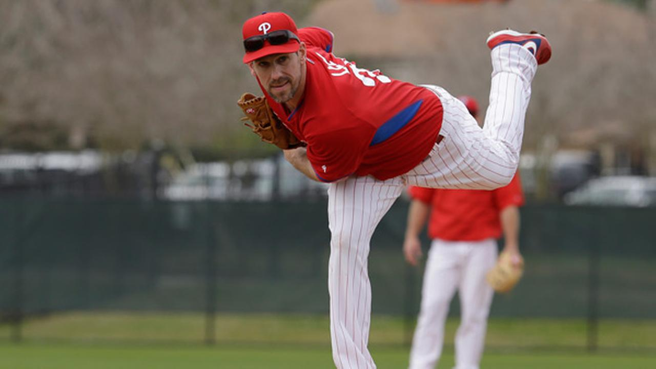 Philadelphia Phillies starting pitcher Cliff Lee follows through on a pitch during a spring training baseball workout, Friday, Feb. 27, 2015, in Clearwater, Fla.