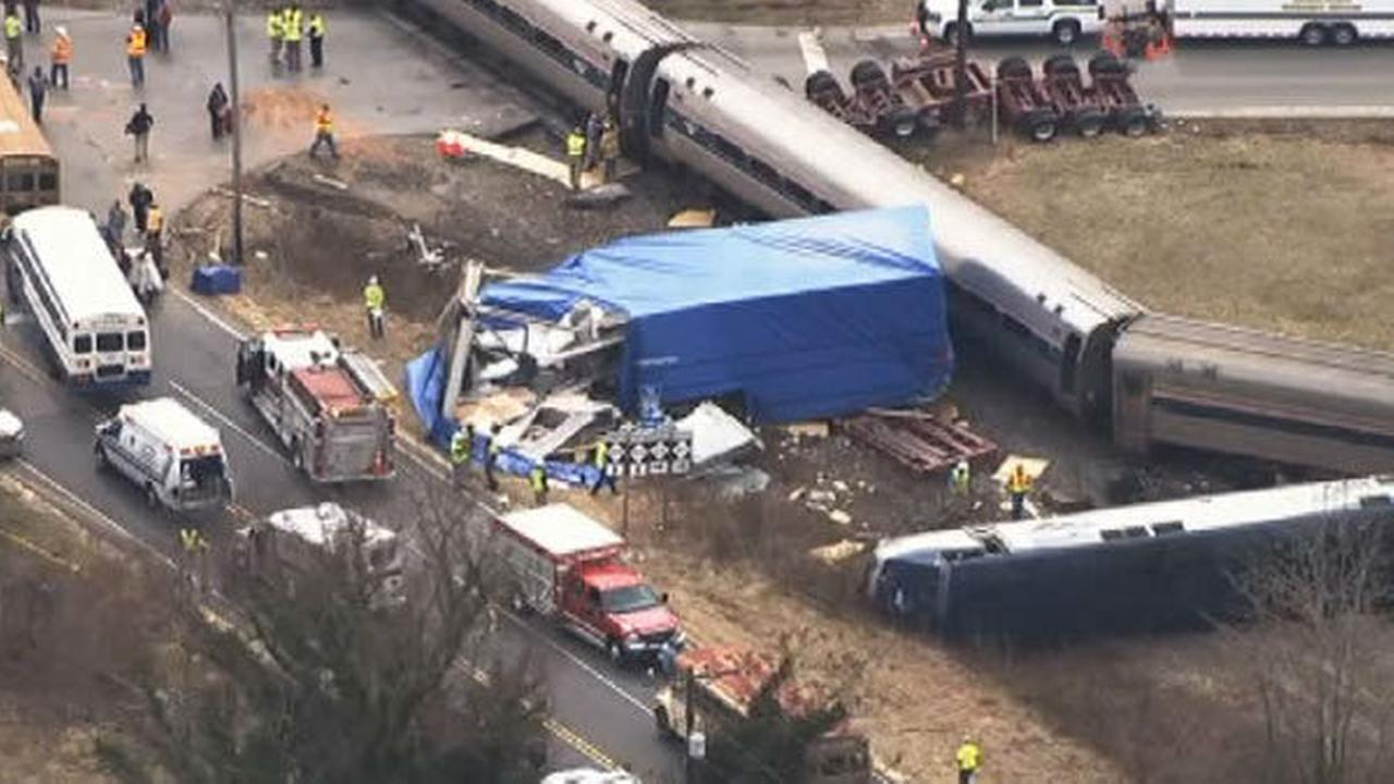 PHOTOS: Amtrak train hits big rig, derails in North Carolina