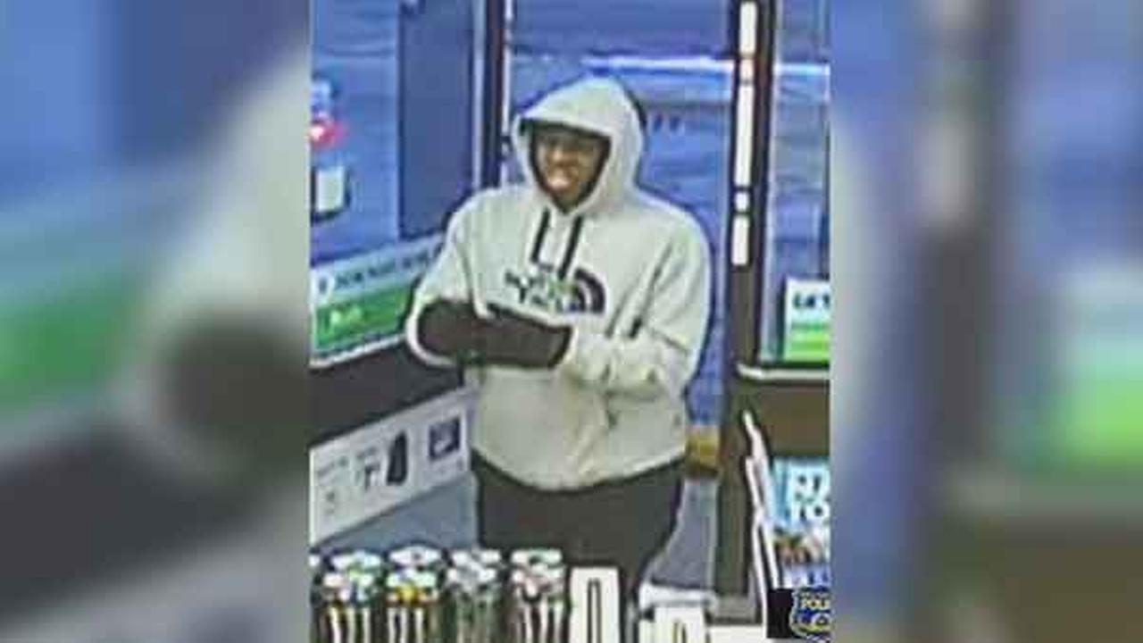 Philadelphia police are searching for an armed suspect who robbed a 7-Eleven in the citys East Oak Lane section Sunday night.