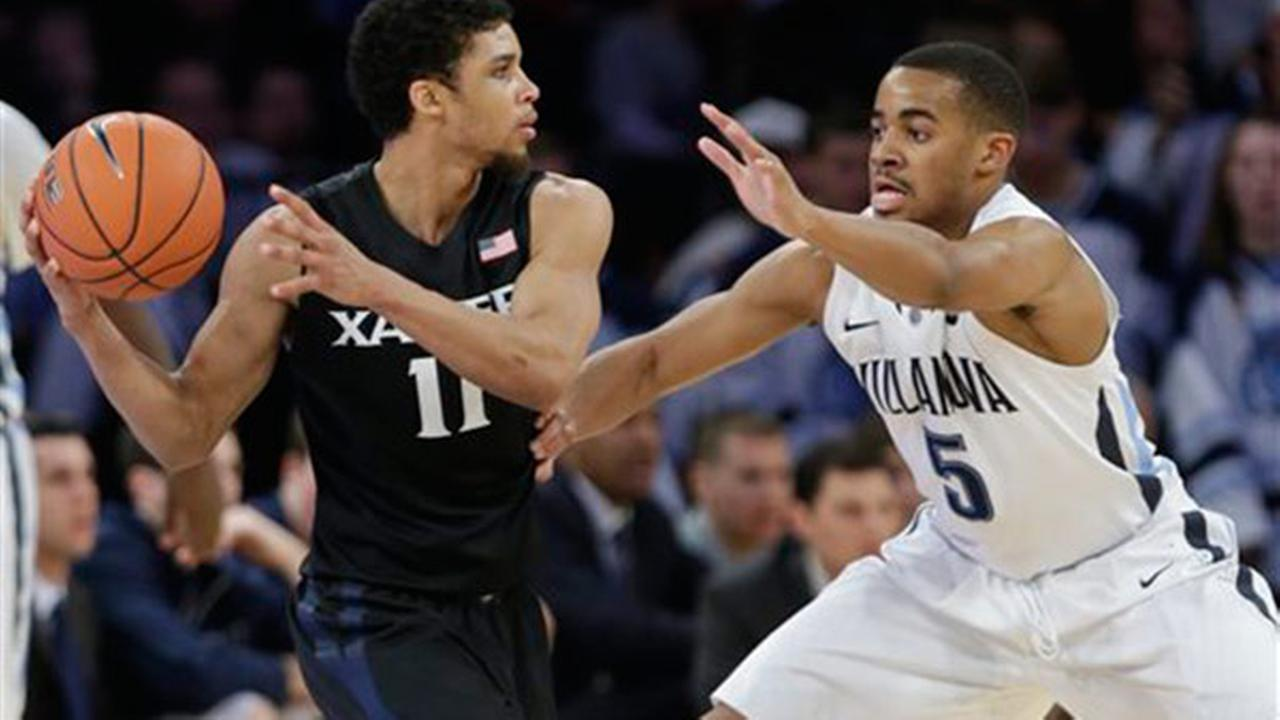 Villanovas Phil Booth (5) defends Xaviers Dee Davis (11) in the finals of the Big East Conference tournament Saturday, March 14, 2015, in New York.