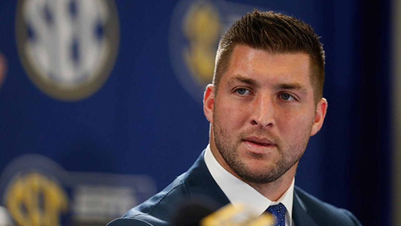 Former NFL player Tim Tebow speaks during a an SEC television broadcast, Friday, Dec. 5, 2014, in Atlanta.