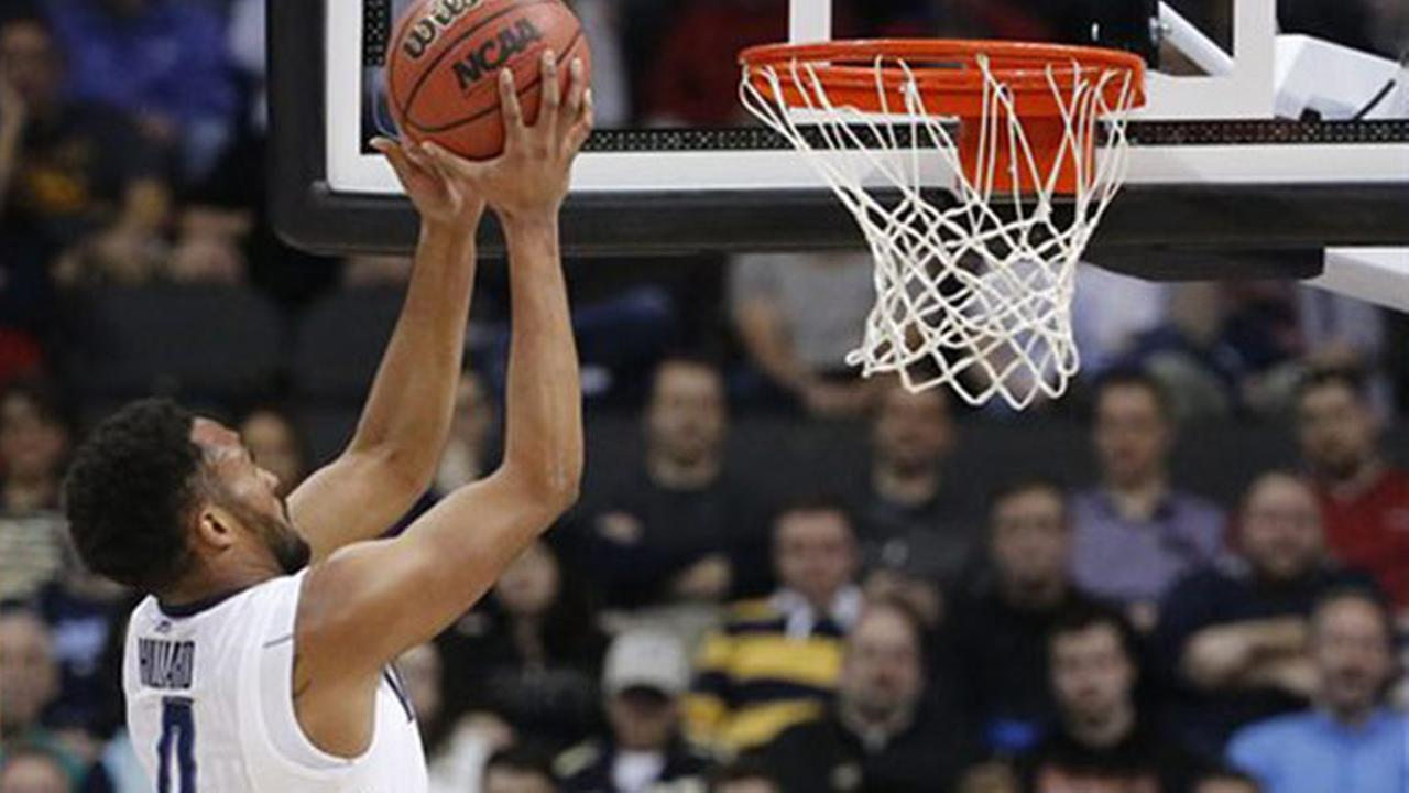Villanovas Darrun Hilliard II (4) shoots during the first half of an NCAA tournament game against North Carolina State, Saturday, March 21, 2015, in Pittsburgh.