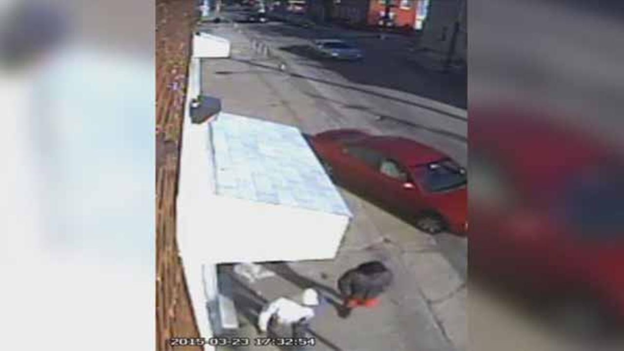 Philadelphia police are searching for two suspects who robbed a deliveryman at knife point in the citys Logan section Monday night.