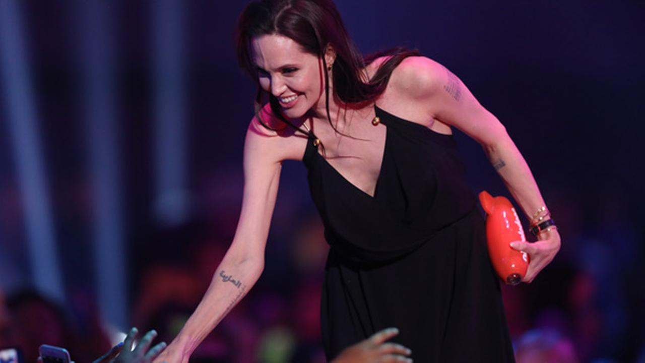 Angelina Jolie accepts the award for favorite villain for Maleficent at Nickelodeons 28th annual Kids Choice Awards at The Forum on Saturday, March 28, 2015.