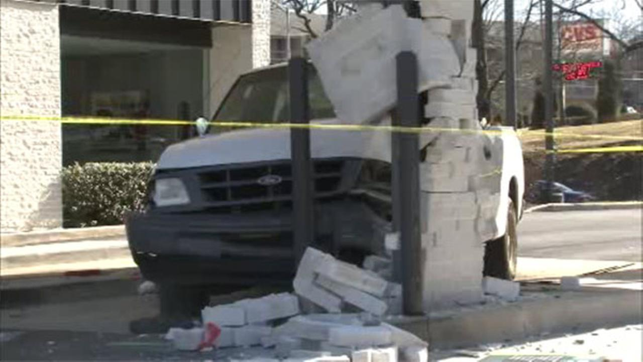Pickup truck crashes into part of bank