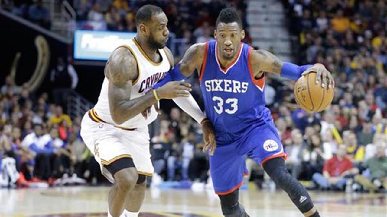 Philadelphia 76ers Robert Covington (33) drives on Cleveland Cavaliers LeBron James, Sunday, March 29, 2015, in Cleveland.