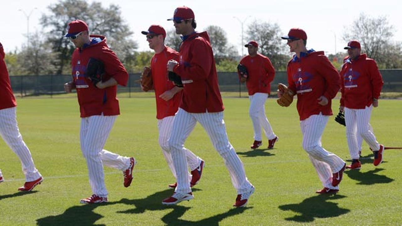 Philadelphia Phillies starting pitcher Cole Hamels, center foreground, runs with teammates during a spring training baseball workout, Thursday, Feb. 19, 2015, in Clearwater, Fla.