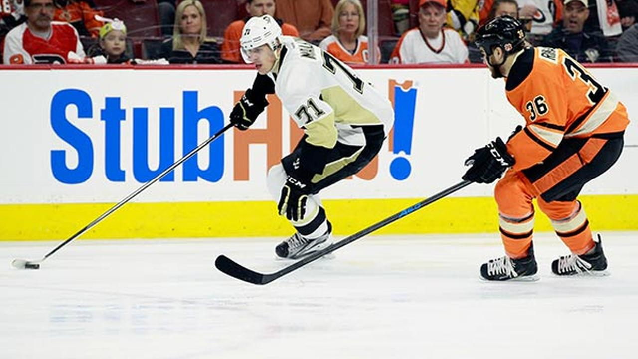 Pittsburgh Penguins Evgeni Malkin, left, is trailed by Philadelphia Flyers Zac Rinaldo in the first period of an NHL hockey game Sunday, April 5, 2015, in Philadelphia.