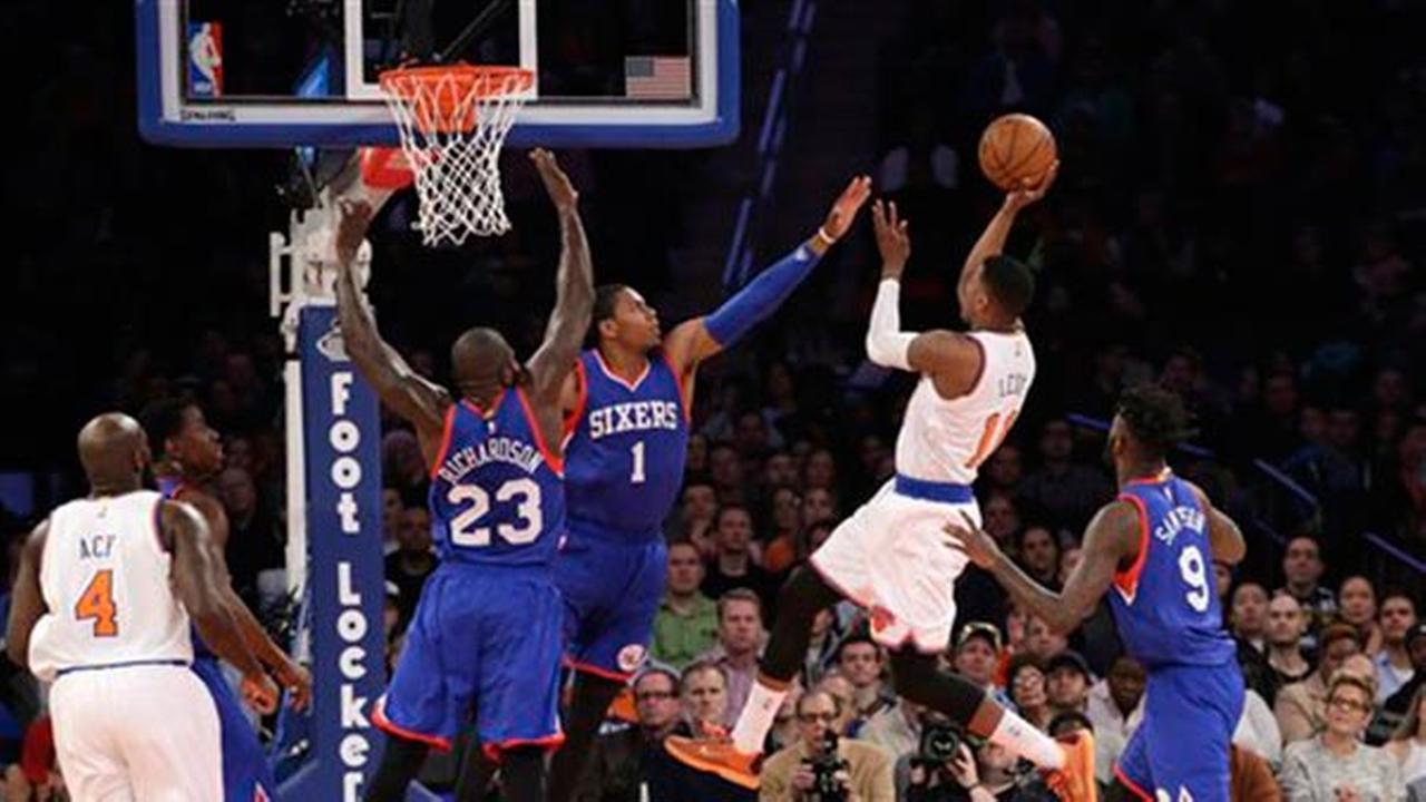 Philadelphia 76ers guard Glenn Robinson III (1) and 76ers guard Jason Richardson (23) defend as New York Knicks guard Ricky Ledo (11) shoots, Sunday, April 5, 2015.