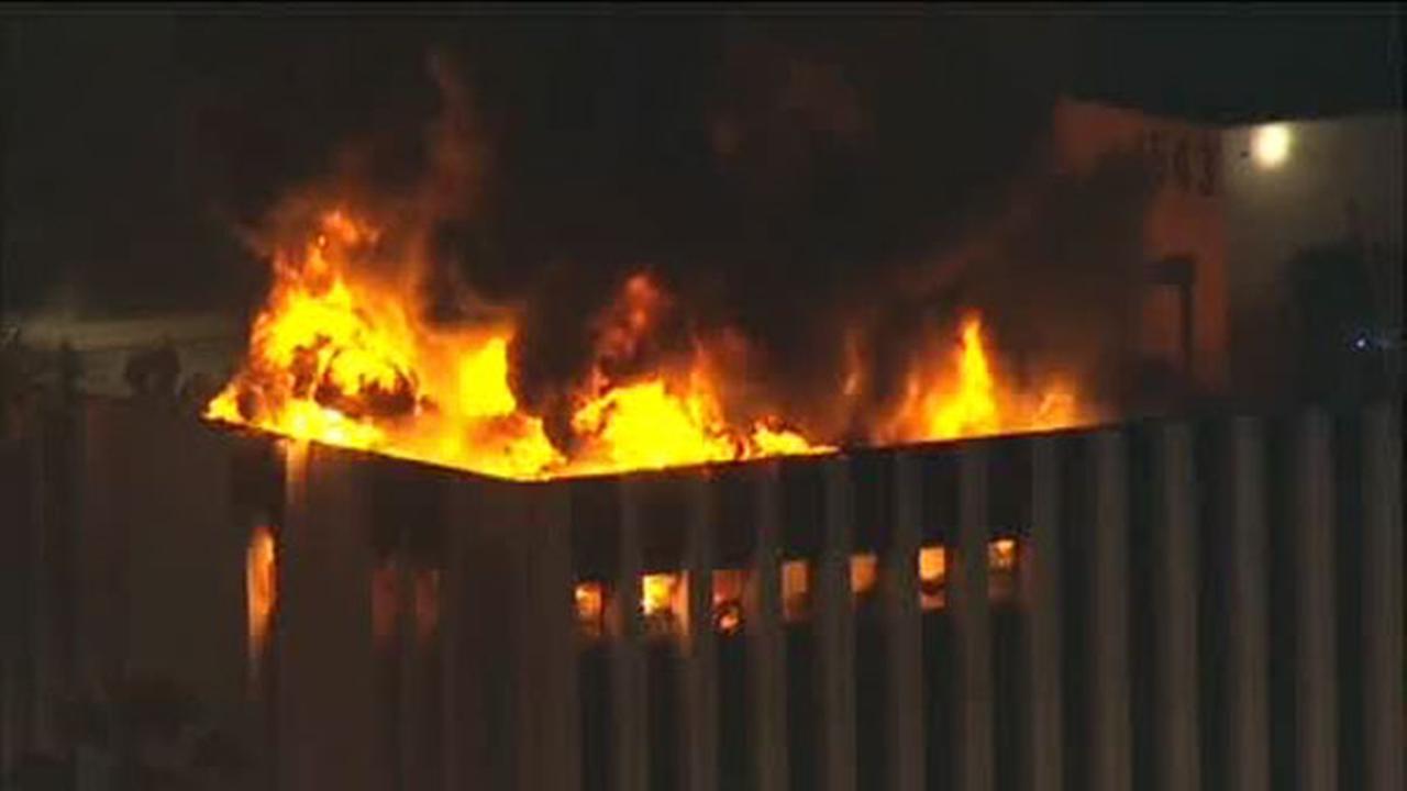 2 rescued, 1 injured as top floors of building burn in LA
