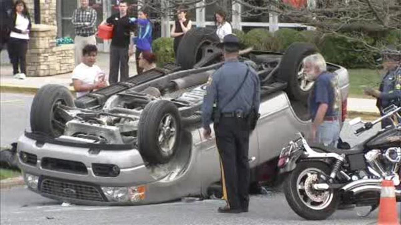 Mother, 2 kids in SUV that flipped in YMCA lot