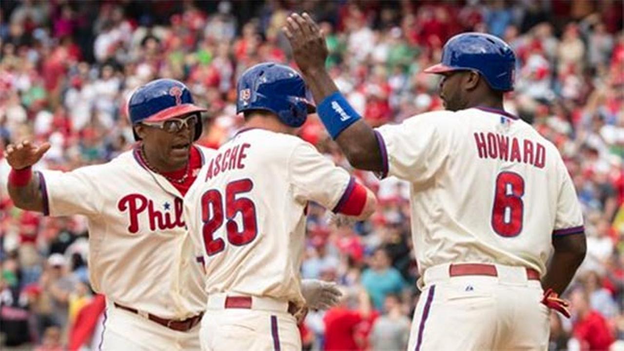 Philadelphia Phillies Cody Asche (center), Marlon Byrd (left), and Ryan Howard (right) against the Cincinnati Reds, Sunday, May 18, 2014, in Philadelphia. The Phillies won 8-3.