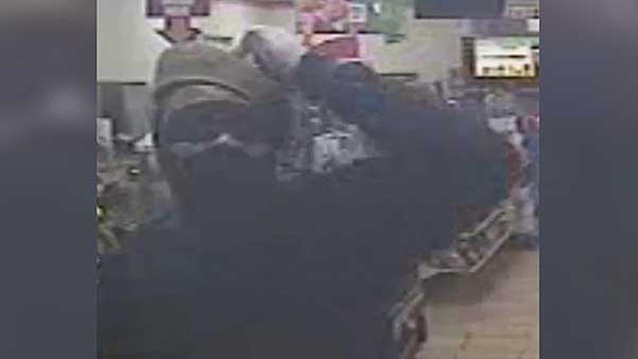 Philadelphia police are looking for a masked man who robbed a 7-Eleven in the citys Tacony section early Sunday morning.