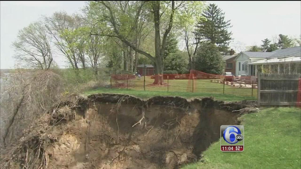 VIDEO: Residents ordered to evacuate after yard collapses