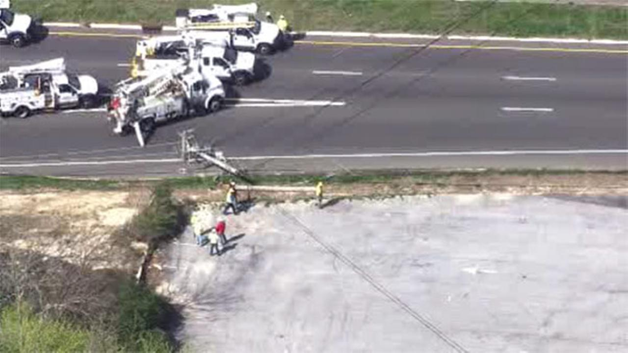 Tractor-trailer crashes into pole, brings down wires