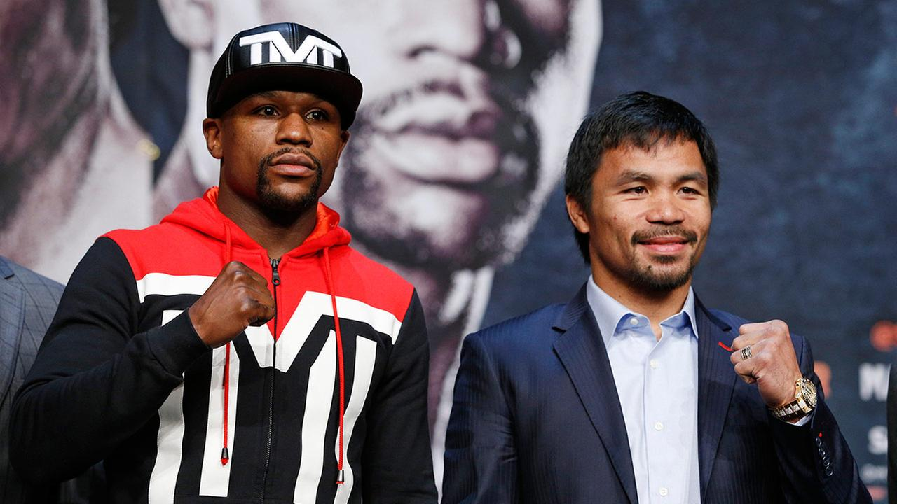 Boxers Floyd Mayweather Jr., left, and Manny Pacquiao pose for photographers  (AP Photo/John Locher)