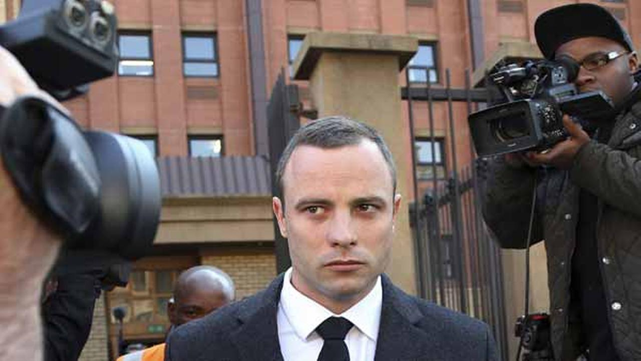 Oscar Pistorius leaves the high court in Pretoria, South Africa, Tuesday, May 20, 2014.