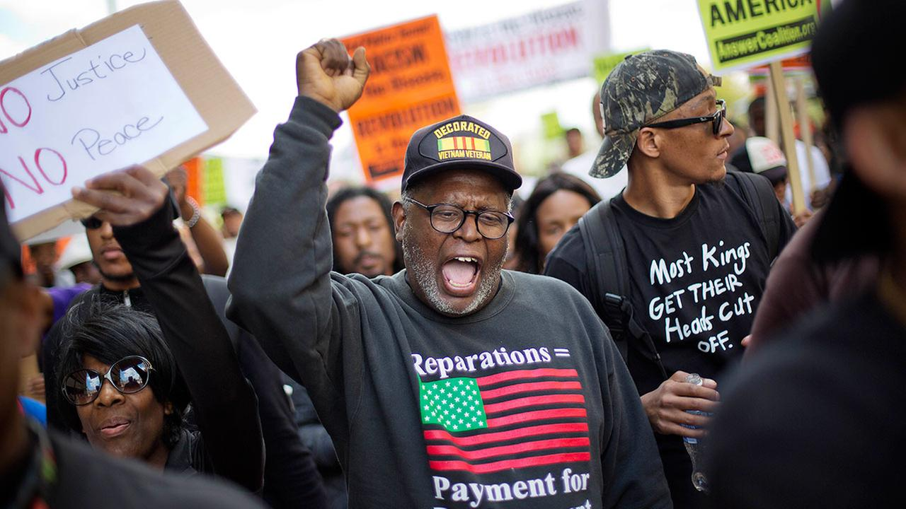 Demonstrators march to City Hall in Baltimore on Saturday, May 2, 2015 (AP Photo/David Goldman)