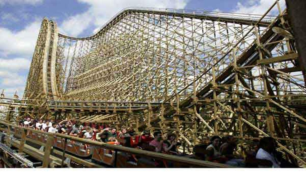 Riders cheer at the end of a minute-and-a-half ride on a new wooden roller coaster, El Toro, at Six Flags Great Adventure in Jackson, N.J.