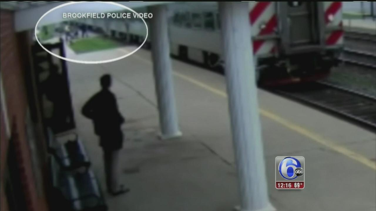 VIDEO: Woman in wheelchair rescued from train tracks
