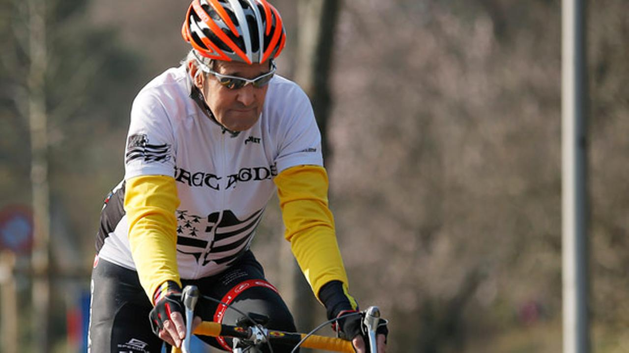 FILE: U.S Secretary of State John Kerry rides his bicycle along the shore of Lake Geneva in Lausanne, Switzerland, Wednesday March 18, 2015.