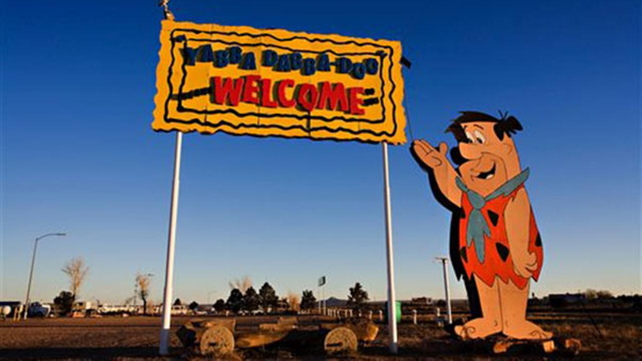 A welcome sign outside Flintstones Bedrock City theme park in Williams, Ariz., is seen in this Nov. 11, 2008 photo provided by Richard Maack.
